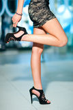 Woman legs and shoes Stock Photography