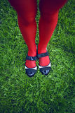 Woman legs in shoes Stock Photography
