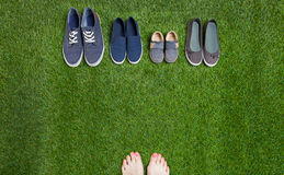 Woman legs and shoes standing  on grass Stock Photo