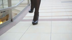Woman legs and shoes and stockings.  stock video footage