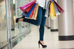 Woman legs with shopping bags Royalty Free Stock Images