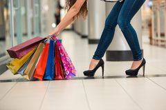 Woman legs with shopping bags Stock Photography