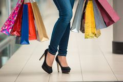 Woman legs with shopping bags Royalty Free Stock Photography