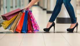 Woman legs with shopping bags Royalty Free Stock Image