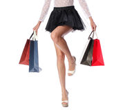 Woman legs with shopping bags Royalty Free Stock Photo