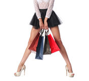 Woman legs with shopping bags Stock Photos