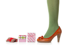 Woman legs and shopping gifts Stock Image