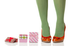 Woman legs and shopping gifts Royalty Free Stock Photography