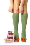 Woman legs and shopping gifts Stock Photos