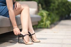 Woman legs in short skirt wearing high heel. Fashion concept Royalty Free Stock Images