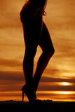 Woman legs side bikini bottoms. A woman legs in a bikini in the sunset royalty free stock photos