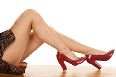 Woman legs sit red heels Royalty Free Stock Photos
