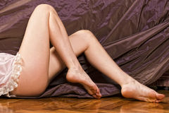 Woman legs soft skin on velvet Royalty Free Stock Photo