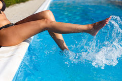 Woman legs splashing Stock Photos