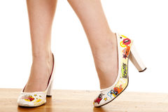 Woman legs stand heels fun close Stock Image
