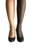 Woman legs with stockings. Of different colors isolated on white Royalty Free Stock Photography