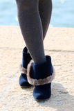 Woman with legs in stockings and boots Stock Photography