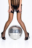 Woman legs in stockings and mirror ball Stock Images
