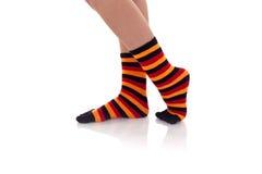 Woman legs in strip socks Royalty Free Stock Photo