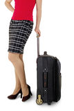 Woman legs with a suitcase. On the white background royalty free stock photo
