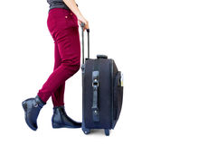 Woman legs with a suitcase Royalty Free Stock Image