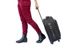 Woman legs with a suitcase Stock Photography