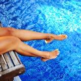 Woman legs in a swimming pool Stock Photo