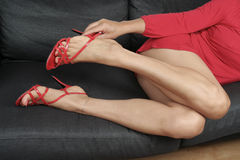 woman  legs taking off shoes  relaxing Royalty Free Stock Photography