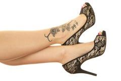 Woman legs tattoo on foot close Stock Photos
