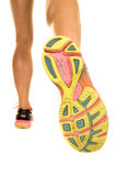 Woman legs very fit from back walk away bottom of shoe Royalty Free Stock Image