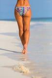 Woman legs walking on the beach. Sand Royalty Free Stock Photo