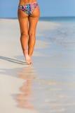Woman legs walking on the beach. Sand Stock Image