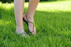 Woman legs walking on grass Royalty Free Stock Photos