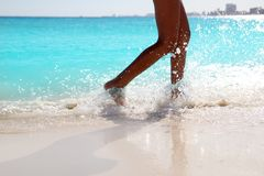 Woman legs walking splashing beach aqua water Royalty Free Stock Photos