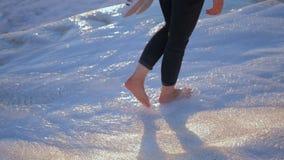 Woman legs walks in the flowing water in Pamukkale. Woman legs walks in the thermal waters of Cotton Castle in Pamukkale Turkey stock video footage
