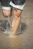 Woman legs in water. A womans legs running and splashing in the water Stock Photography
