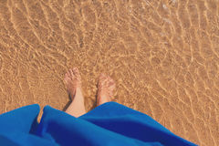 Woman legs in water Royalty Free Stock Image