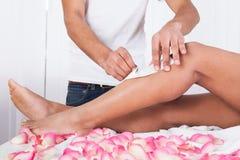 Woman legs waxed Stock Photo
