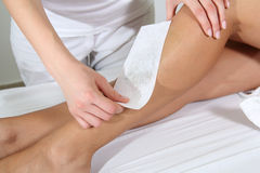 Woman Legs Waxed In Spa Stock Photography