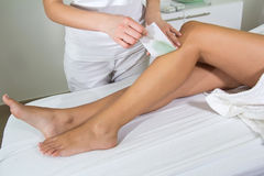 Woman Legs Waxed In Spa Royalty Free Stock Images