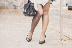 Woman legs wearing black high heel shoes Royalty Free Stock Images