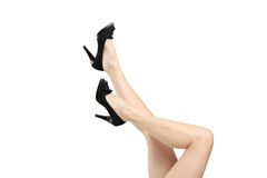 Woman legs wearing black high heels shoes Royalty Free Stock Photos