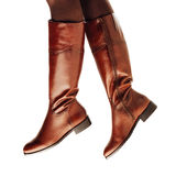 Woman legs wearing brown leather high boots Stock Photos