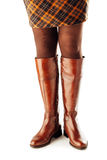 Woman legs wearing brown leather high boots Royalty Free Stock Photography