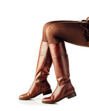 Woman legs wearing brown leather high boots Royalty Free Stock Photos