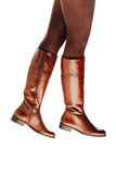Woman legs wearing brown leather high boots Royalty Free Stock Image