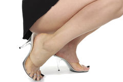 Woman legs wearing high heels Stock Images