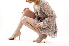 Woman legs wearing high heels  on white background Stock Image