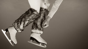 Woman legs wearing ice skates fur socks, skating Royalty Free Stock Photos