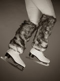 Woman legs wearing ice skates fur socks, skating Stock Photography